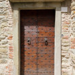 Vintage double wooden door with studs — Stock Photo