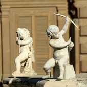 Two Cupids with bow — Stock Photo
