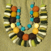 Three rows of handmade stylish colorful felt necklaces — Stock Photo