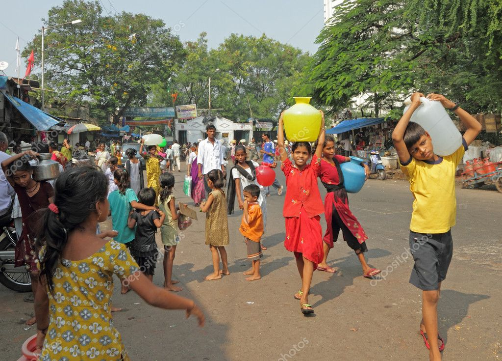 MUMBAI,INDIA-NOVEMBER 26:Children carrying water on Nov.26, 2010 in Mumbai. Poor children in India begin working at a very young and tender age. Many children have to work to help their families.  Stock Photo #14777801