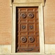 Antique carved wooden door - Stock Photo