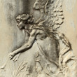 Angelic bas-relief — Stockfoto