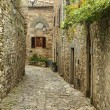 Narrow street in italian village — Stock Photo