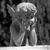 Figure of angel - detail of the fountain in garden of Villa Peyr — Stock Photo