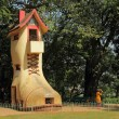 The giant Shoe House for children in Hanging Gardens and the adj — Stock Photo
