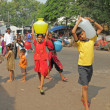 MUMBAI,INDIA-NOVEMBER 26:Children carrying water on Nov.26, 2010 — Stock Photo
