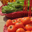 Vegetables in baskets on farmers market in Spain - Stock Photo