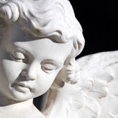 Angel face - detail of artistic sculpture, Italy — Stock Photo