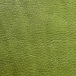 Green leather texture as background — Foto Stock