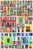 Pared abstracto con muchos colores viejas ventanas con postigos, ital — Foto de Stock