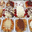 Variety of Belgian waffles on street stall in Brussels, Belgium, — Stock Photo