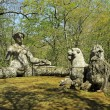 The bench like siren and two lions sculptures in Park of the Mon — Stock Photo