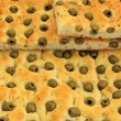 Focaccia with green olives, focaccia is  flat oven  baked Italia — Stock Photo