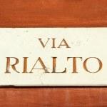 Marble street sign : Via Rialto ( Rialto name of famous venetian — Stock Photo #27392575