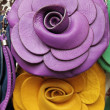 Violet and yellow handbags in shape of flower on leather market  — Stock Photo