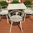 Vintage garden furniture on tuscan roof terrace, Florence, Italy — Stock Photo