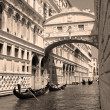 Stock Photo: Gondolas passing over Bridge of Sighs - Ponte dei Sospiri. Venic