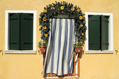 Cute doorway framed with garland wreath and striped door curtain — Stock Photo