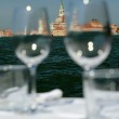 Постер, плакат: Weinglasses in outdoor restaurant with fantastic view of veneti