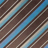 Fabric with diagonal various widths blue , black and white stri — Stock Photo