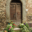 Antique doorway to the tuscan house, Anghiari, Italy — Stock Photo #30669483