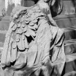 Lying angel sculpture at the tomb — Stock Photo