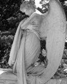 Beautiful kneeling angelic statue — Stock Photo