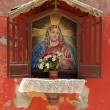 Figure of Jesus in a shrine on the wall — Stock Photo