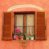 Lovely window with angelic decor and flowers — Stock Photo