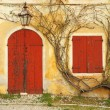 Stock Photo: Beautiful colorful old doorway with blinded door and window