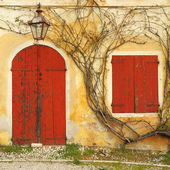 Beautiful colorful old doorway with blinded door and window — Stock Photo