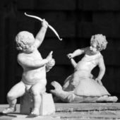 Detail with playing cherubs — Stock Photo