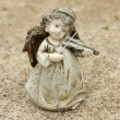 Постер, плакат: Little angel figurine playing violin