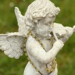 Постер, плакат: Statue of little angel playing violin