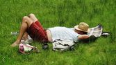 Man lying in the grass — Stock Photo