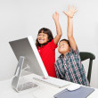 Royalty-Free Stock Photo: Children at Computer Raising Hands in School Classroom
