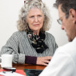 Worried Woman Talking with Her Doctor — Stock Photo #16162203