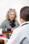 Worried Woman Talking with Her Doctor — Stock Photo