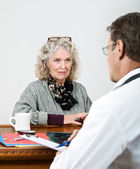 Mature Woman Listening to Her Doctor — Stock Photo