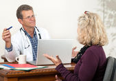 Male Doctor and Female Patient Discuss Medical Treatments — Stock Photo
