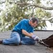 Man Repairing Leaking Roof — Stock Photo #17006357