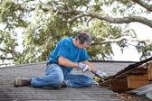 Man Repairing Leaking Roof — Stock Photo