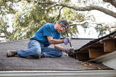 Man Repairing Leaking Roof — Photo
