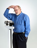 Senior Male on Weight Scale — Stock Photo