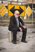 Which Way to Go? Old Businessman Ponders Uncertain Future — Stock Photo