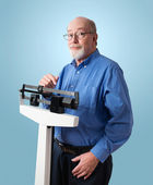 Happy Senior Man on Weight Scale — Stock Photo