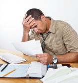 Worried Man with Debt and Bills — Stock Photo