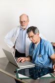 Senior Medical Doctors Discussing Patients MRI Film Scans — Foto Stock