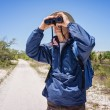 Man Hiking and Birdwatching and Looking Through Binoculars — Stock Photo #25276075