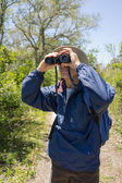 Man Hiking, Birdwatching and Looking Through Binoculars — Stock Photo